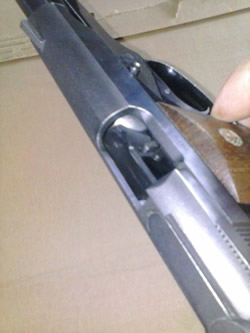 How to Clean a 1911 - Clearing chamber of 1911 pistol.