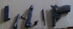 How to Clean a 1911 - 1911 pistol parts ready for cleaning.