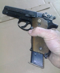 How to Clean a 1911 - Loading 1911 pistol magazine.
