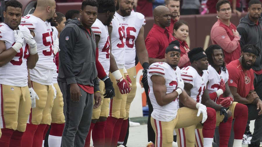 New season: NFL players kneel, raise fists during anthem; Trump tweets response