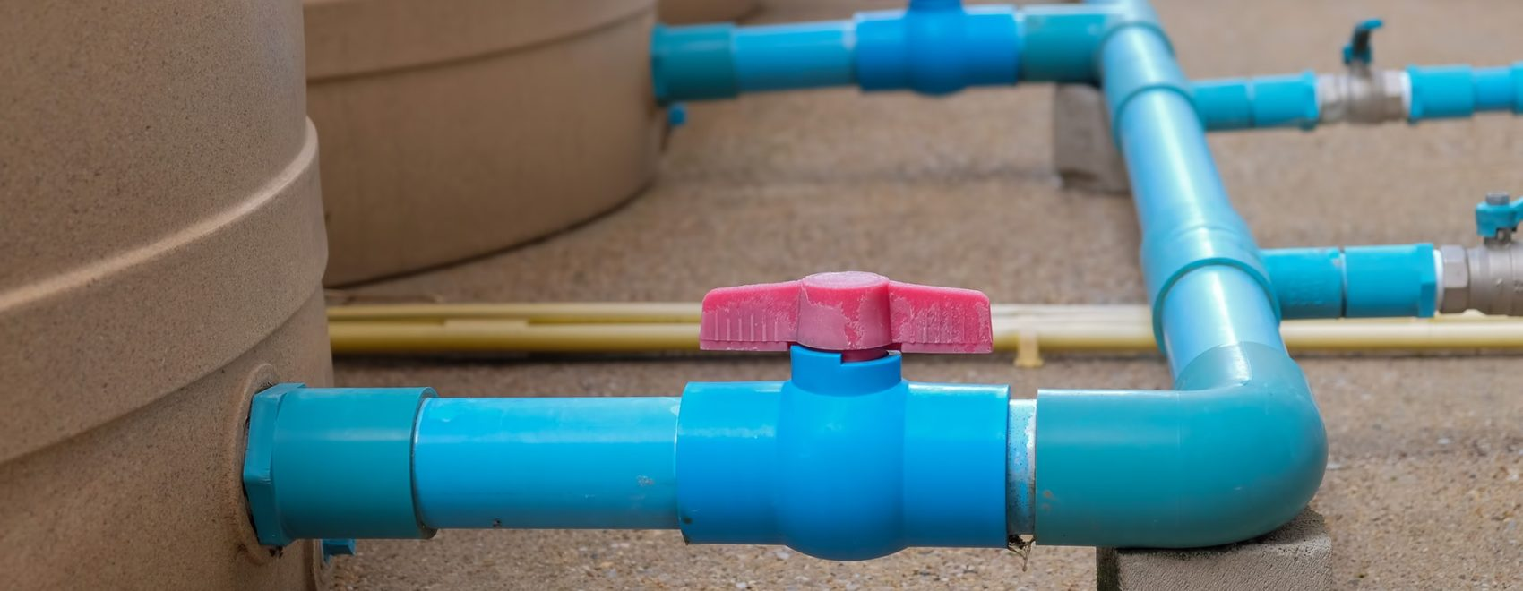 Blue water pipe installation from pump to tank.