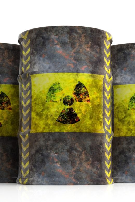 Radiation symbol on oil barrels, white background. 3d illustration