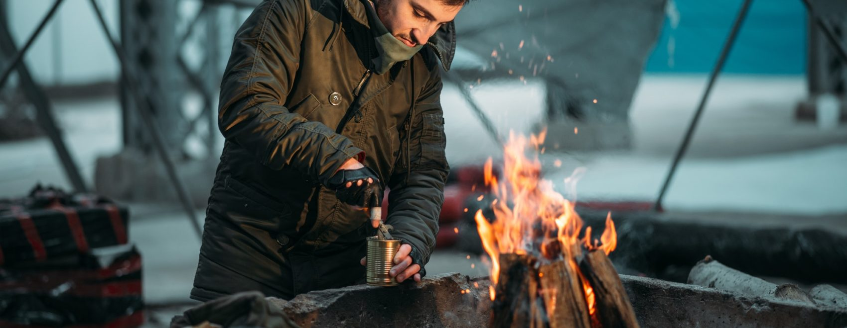 Financial Survival for Doomsday Preppers person cooking canned food on fire